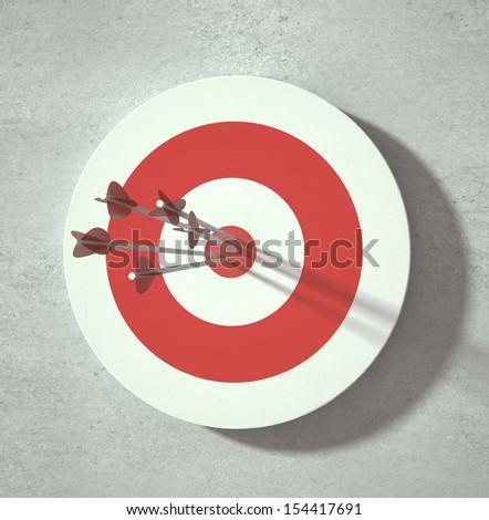 Red darts target aim. Successful shoot. - stock photo