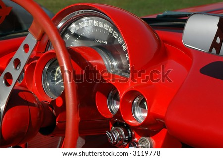 red dashboard on vintage sports car - stock photo