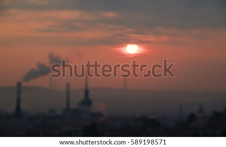 Red dawn at city of Brno during smog situation, tilt shift photo