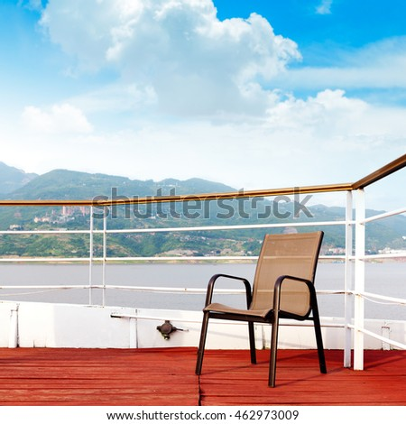 Red deck chairs and no one