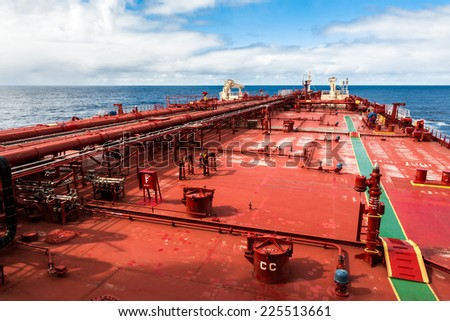 Red deck of a crude oil products tanker - stock photo