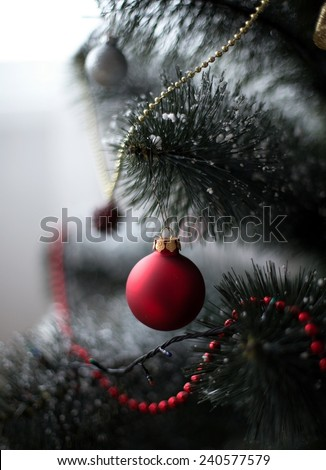 Red decoration ball on the christmas tree  - stock photo