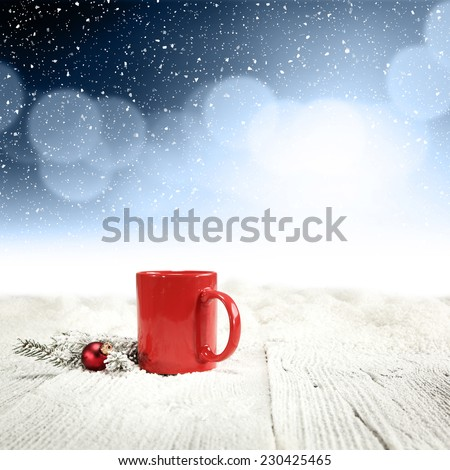 red decoration of mug and snow  - stock photo