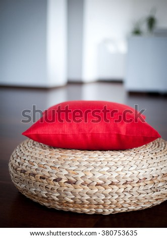Red decorative pillow in interior. Red accent pillow in interior for home decor  - stock photo