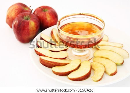 Red delicious variety of apple with a bowl of honey, symbolic of the Jewish New Year. - stock photo