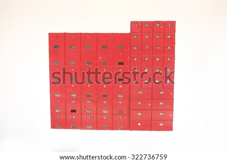Red deposit /post locker boxes at wall  - stock photo