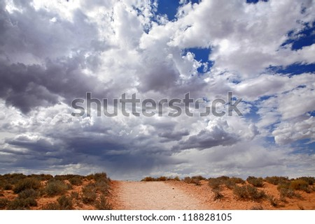 Red desert and cloudy sky, Page - Arizona USA - stock photo