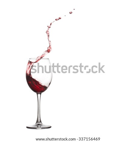 Red dessert wine glass splash and drops. Pouring wine, splashing into crystal glass., close-up, white background. copy space. - stock photo
