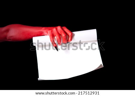 Red devil hand holding paper scroll, Halloween deal with devil concept - stock photo