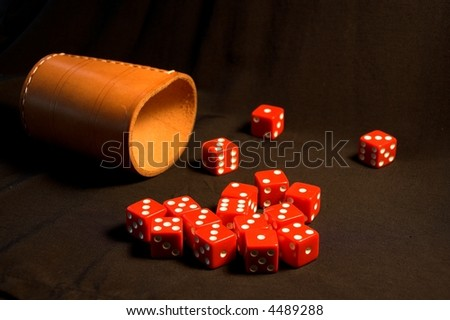 Red dice against black background