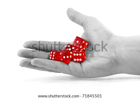 Red dice in a desaturated hand. - stock photo