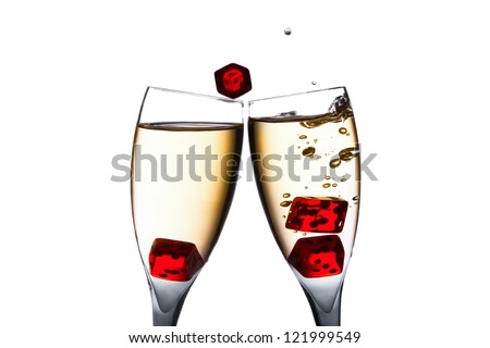 red dice in movement in two flutes with gold bubbles on white background - stock photo
