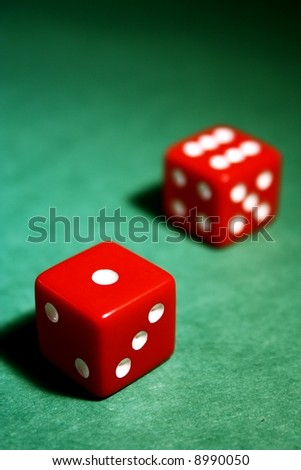 red dice on a green background - stock photo