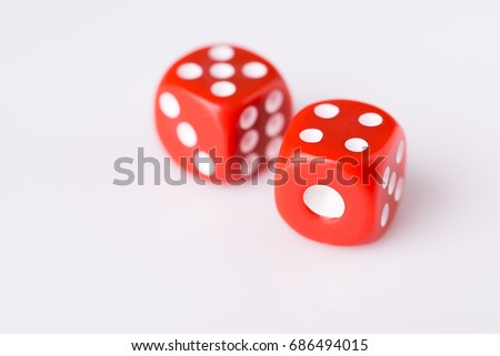 Red dice on white background with copy space