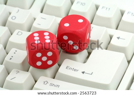 red dices and keyboard, concept of online gambling - stock photo
