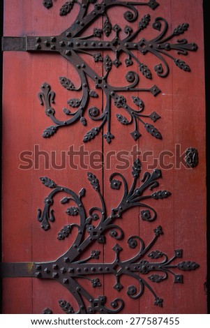 Red door detail with wrought iron ornaments, Notre dame de Strasbourg cathedral