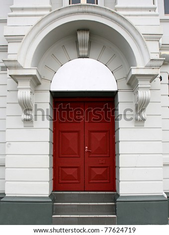 red door in a white arch - stock photo