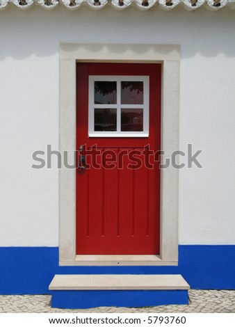 Red door of a house in a small village: Alentejo - Portugal - stock photo