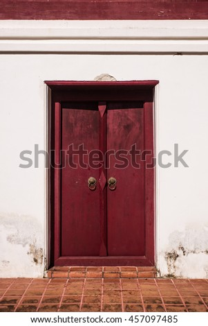 red door of the church in temple, Thailand - stock photo