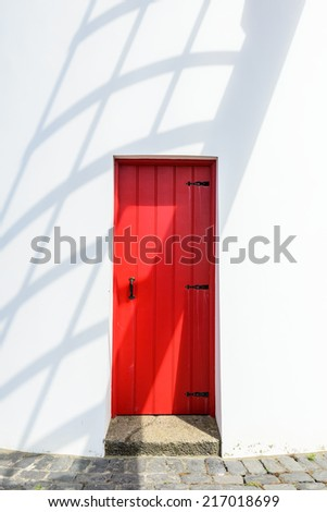 Red door of windmill, Sao Miguel, Azores, Portugal, Europe - stock photo