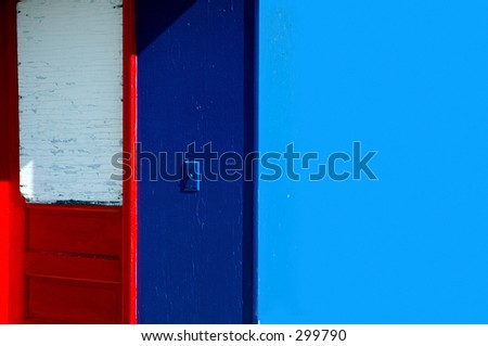 Red Door on Blue Wall