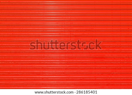 Red door shuttered roll up metal  red door - stock photo