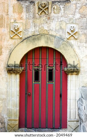 Red door to the Santa Barbara mission cemetery - stock photo