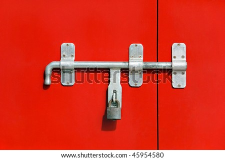Red door with iron lock