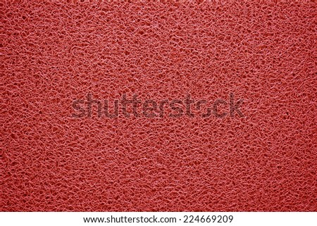 Red doormat texture background.