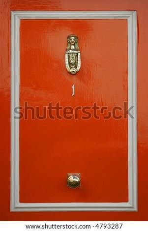 Red doors with door knocker - stock photo