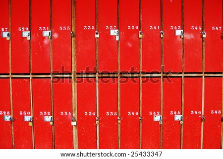 Red doors with numbers and locks - stock photo