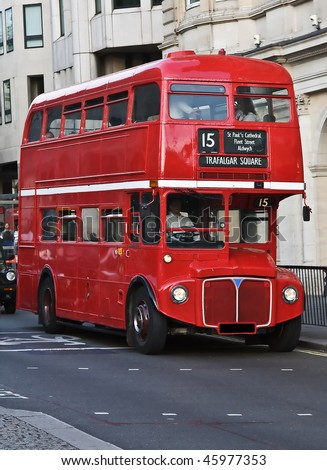 Red double decker on the streets of London - stock photo