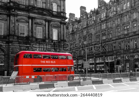 red double decker vintage bus in a street - stock photo