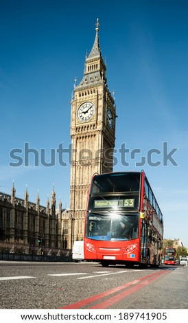Red doubledecker bus in front of Big Ben in London