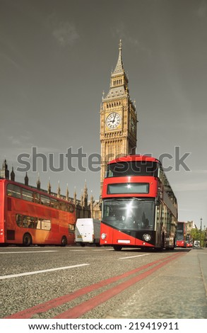 Red doubledecker bus in front of Big Ben in London, UK. Toned image - stock photo