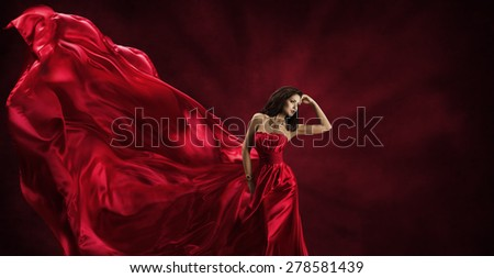 Red Dress, Woman in Flying Fashion Silk Fabric Clothes, Model Posing with Blowing Waving Cloth, Beauty Concept - stock photo