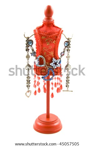 Red dressed dummy with jewelery isolated over white - stock photo