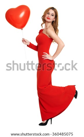 red dressed woman with heart shape balloon on white - stock photo