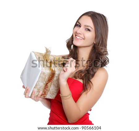 Red dressed women with a gift - stock photo