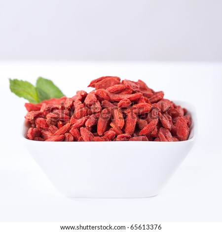 red dried goji berries in a bowl