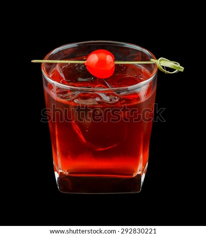 Red drink that contains vodka, rose syrup, grenadine and cranberry juice and is garnished with a maraschino cherry. Isolated on black. - stock photo