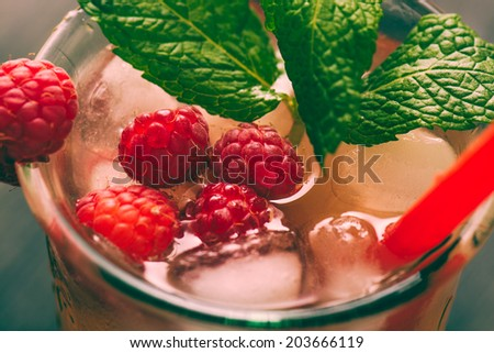 Red drink with raspberries, ginger and ice - stock photo