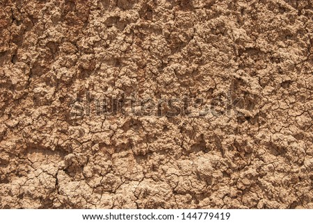 Red dry clay loam closeup as background - stock photo