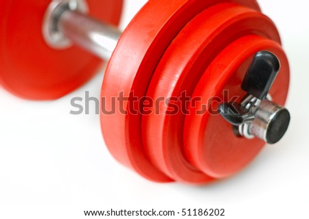red dumbbell on white background - stock photo