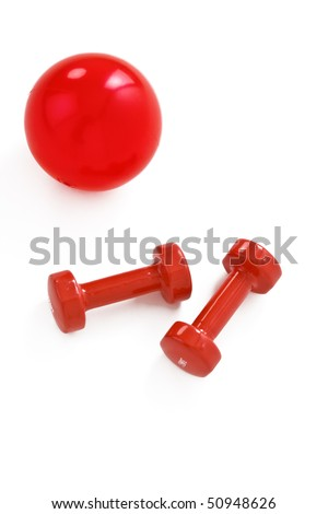 Red dumbbells and fit ball - stock photo