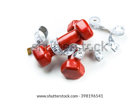 Red dumbbells, fitness concept