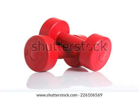 Red dumbbells weight isolated on white background - stock photo