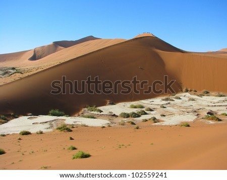 Red dune in Deadvlei (Death valley), Sossusvlei, Namib-Naukluft National Park of Namibia - stock photo