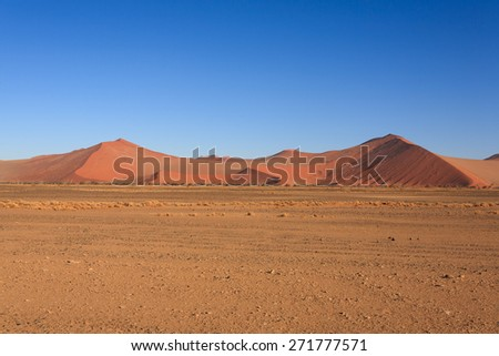 Red dunes on the road to Sossusvlei, Namibia - stock photo