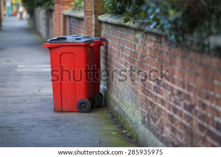 Red dustbin - stock photo